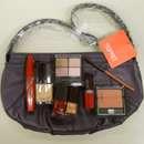 2 x 1 lila ESPRIT-Bag mit 8 Esprit cosmetics Produkten zu gewinnen